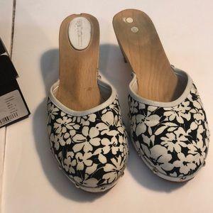 Burberry black/white floral clogs.